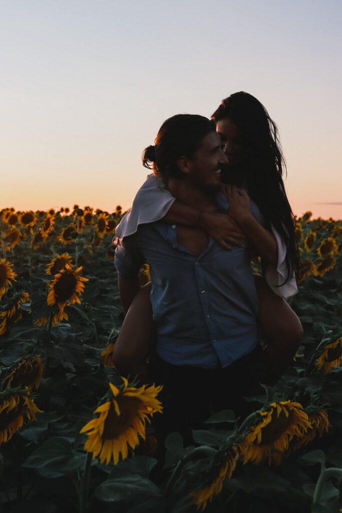 couple in sunflower field