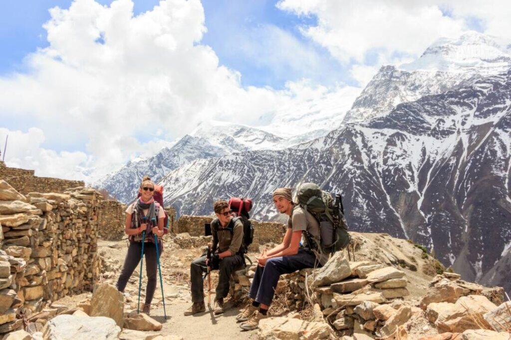 trekkers in nepali mountains